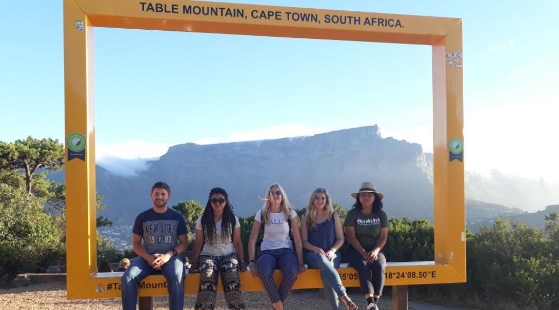 Projects Abroad volunteers taking a picture with unique bucket list destination Table Mountain in the background